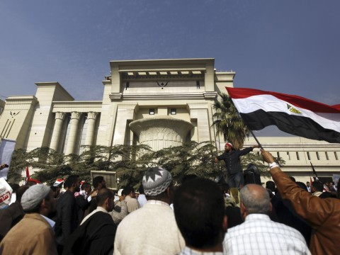 Supporters of Egyptian President Mohamed Mursi shout slogans in front of the Supreme Constitutional Court in Maadi