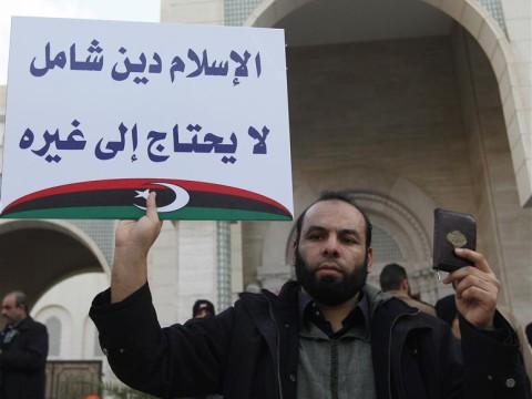 Libyan Muslim demonstrates in Tripoli's Algeria Square