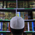 Man wearing an Islamic prayer cap, or